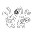 easter bunnies with easter egg and flowers vector image