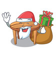 santa with gift wooden table isolated on the vector image vector image