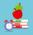 pile books with alarm and apples vector image