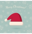 Christmas hat on winter backdrop vector image vector image