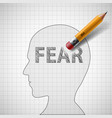 pencil erases the word fear in the human head vector image
