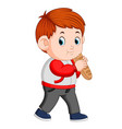 a boy with big loaf of bread vector image vector image