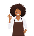 woman in apron gesturing ok sign vector image vector image