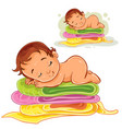 a baby sleeping on a pile vector image vector image
