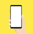 hand holding smart phone on yellow background vector image vector image
