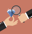 Hand holding magnifying glass with diamond vector image vector image