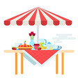 table with umbrella and a set for tea drinking vector image vector image