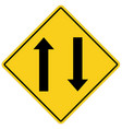 two way traffic ahead sign on white background vector image vector image
