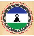 Vintage label cards of Lesotho flag vector image