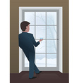 Businessman looking out the window vector image