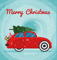 Retro red car with Christmas tree on the roof vector image vector image
