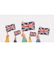 human hands hold english great britain flags vector image vector image