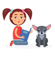 small girl reads blue book to little chihuahua vector image vector image