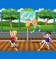 three boys playing basketball at court