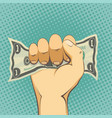 human hand holding a dollar bill cash payment vector image
