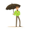 man reporter with microphone stands under umbrella vector image