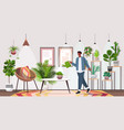 man with watering can taking care houseplants vector image