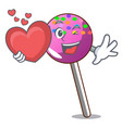 with heart lollipop with sprinkles mascot cartoon vector image