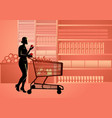 woman in supermarket with shopping trolly vector image