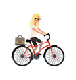 young blond girl riding bicycle to work in vector image vector image