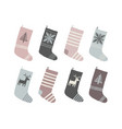 set of red and white christmas socks cartoon new vector image vector image