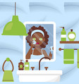 woman cleaning face in bathroom vector image