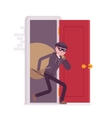 Thief carring loot through the door vector image