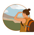 young woman walking alone on a mountain trail vector image vector image
