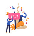 sale table placed by shop worker with leaves vector image