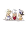 three friends on beach young women sitting