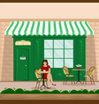 a girl with a cup of coffee at a table in a cafe vector image vector image