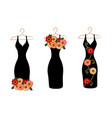 set of dresses on hangers vector image