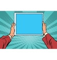 Pop art electronic tablet in the hands vector image
