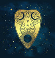 gold divination board planchette over the blue sky
