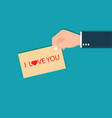 Human hands holding i love you lettering card