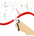 hand cutting red ribbon with scissors vector image