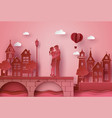 a couple standing hugging the seaside village vector image vector image