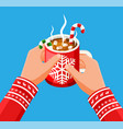 coffee mug with marshmallows and candy cane vector image