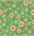 seamless pattern with red snowflakes on a green vector image