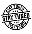stay tuned round grunge black stamp vector image vector image