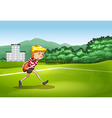 Boy playing rugby in the field vector image