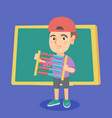 boy with abacus on the background of blackboard vector image vector image
