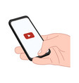 hand holds a smartphone with a play video icon vector image