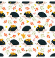 seamless pattern with hedgehogs and leaves vector image