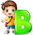little boy holding letter b vector image vector image