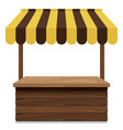 wooden market stall with yellow and brown awning