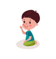 cute dark haired little boy sitting on the floor vector image vector image