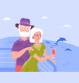 two smiling senior spouses relax on ship vector image vector image