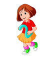 cute child holding balloon with number two vector image vector image