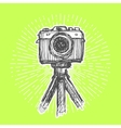 Single-lens reflex camera on tripod vector image vector image